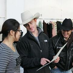 Jet & Cord checking with a fashion designer during the tenth leg.