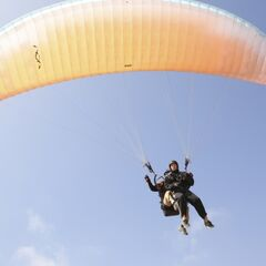 Tim paragliding during the <a href=