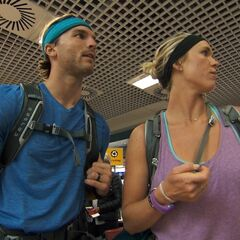 Adam & Bethany at the airport to get to their next destination in the <a href=