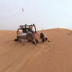 Joseph & Grace's Dune Buggy bogged down in the desert during the Detour in United Arab Emirates