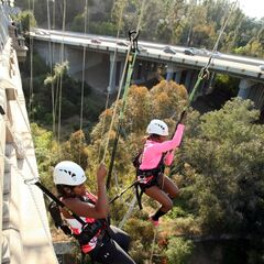 The twins rappeling down to reach their first clue of the race.