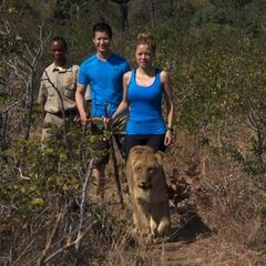 Cindy & Rick walking with Lions