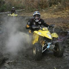 Andy & Laura riding all-terrain vehicles in the sixth leg.