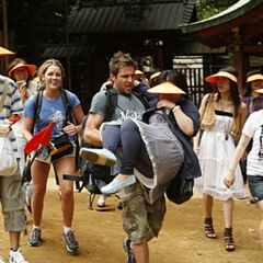 Mika carries one of the tourists to the first leg's <a href=