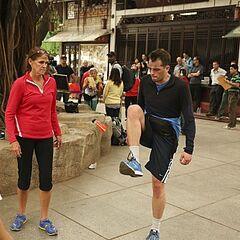 Margie &amp; Luke doing the <i>Featherball</i> Detour in Leg 2.