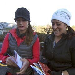 Mona & Beth reading the Roadblock clue in the <a href=