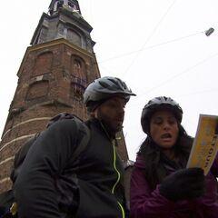 Matt & Ashley reading their Detour clue in the ninth leg.