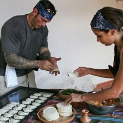 Vanessa & Ralph making empanadas during the first leg.