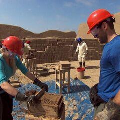 Hayley &amp; Blair doing the <i>Make Some Bricks</i> Detour in the eleventh leg.