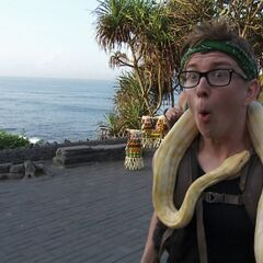 Tyler carrying a snake around his head in <a href=