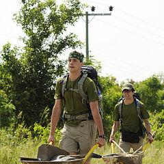Connor & Jonathan pushing wheelbarrows during the third leg.