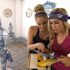 Ally & Ashley reading the clue after completing the Detour.