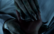 Norman's clawed hands TASM2