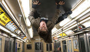 Peter sticks to the subway ceiling