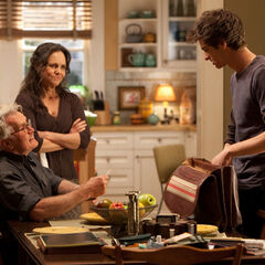 Peter speaks with his Uncle Ben and Aunt May.