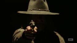 The Saint points his gun toward Jesse