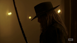 The Saint of Killers looks at his bloodied saber