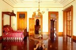 Royal-furniture-and-artifacts-in-a-room-of-iolani-palace-a-four-story-A