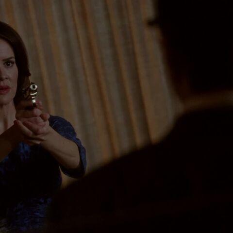 Lana aiming a gun at <a href=
