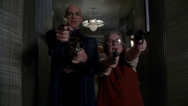 File:Hotel 5x11 Liz Taylor & Iris shooting guns.png