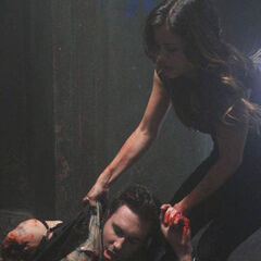 Teresa trying to save Leo while attempting to flee from Bloody Face.
