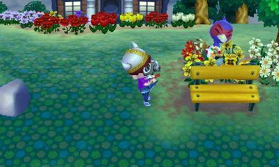 File:Phil watering a flower.jpg