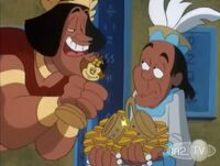 Montezuma holding a Dot statue