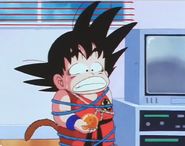 Kid goku tied up in blue ropes