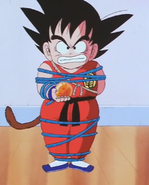 Kid goku tied up in blue ropes2