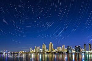 Star-trails-over-city-skyline