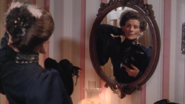 "Hetty at mirror ""The Dinner"""