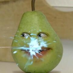 Marshmallow disguised as Pear being squirted with water by Grapefruit disguised as Midget Apple