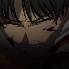 Manabu grits his teeth in pain.