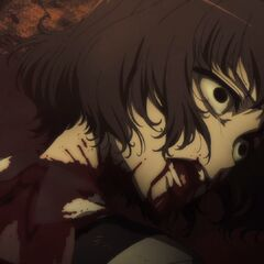 Aki lies in a pool of her own blood, a look of agony on her face.