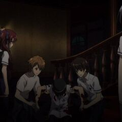 Naoya and Kouichi help Manabu get to safety.