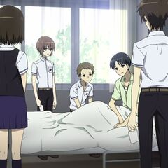 Manabu at the hospital with his friends.