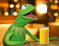 Kormit about to enjoy a refreshing glass of orange juice.png