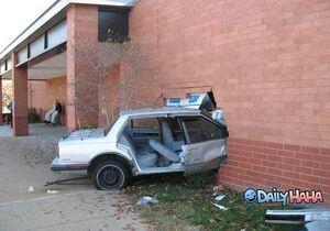 Car crash brick wall