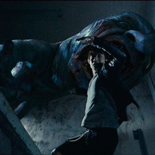 Takuro about to be eaten by the Oni in the movie.