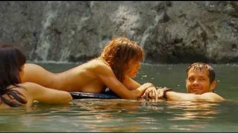 Kiele Sanchez, Naked, A Perfect Getaway, Laying on surfboard. kielesanchez.com