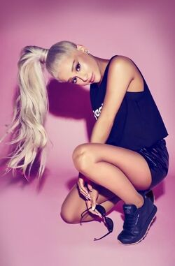 Ariana platinum hair pink background for reebok