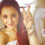Ariana showing the peace sign