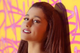 File:Ariana against yellow and pink.jpg