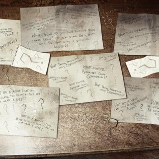 Pertences e anotações do Charada.