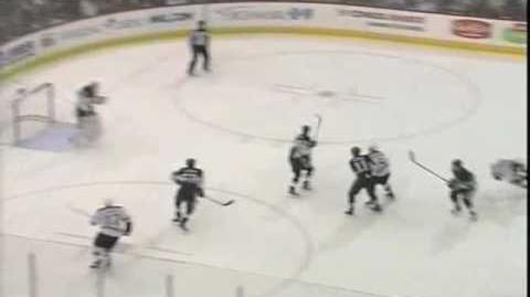 Matt Cooke knocks Marc Savard out