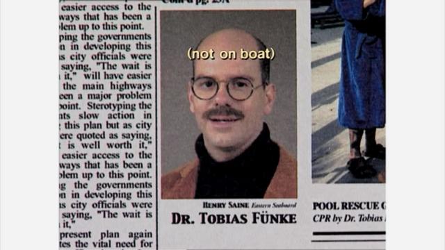 File:1x01 Tobias newspaper closeup.png