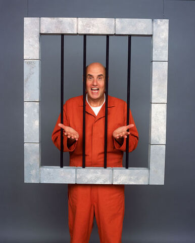 File:Publicity - George behind bars.jpeg