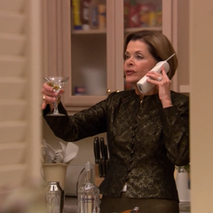 Lucille drinks a Cloudmir martini in