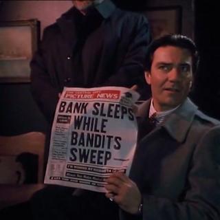 Stan Morris porte le journal <a class=