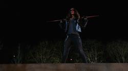 Dinah in her vigilante costume